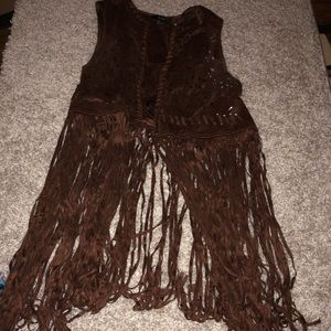 Cow girl looking vest with long cut strings